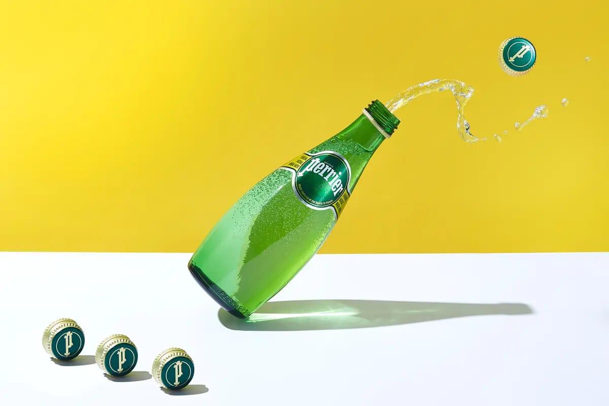 Perrier sparkling water splashing as creative advertising photography