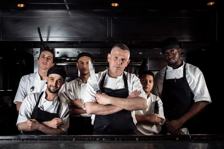 Head chef and his kitchen crew at London restaurant, lifestyle photography