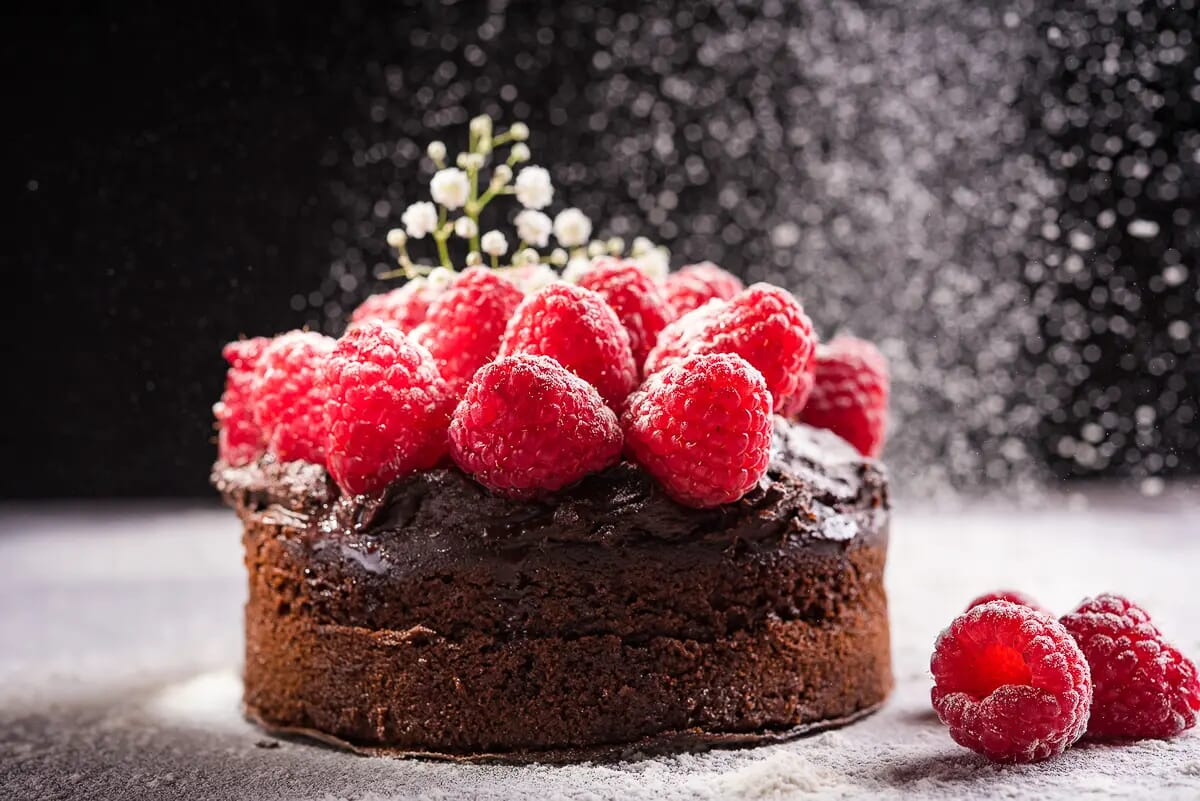Chocolate and raspberries cake snowing icing sugar commercial food photography London